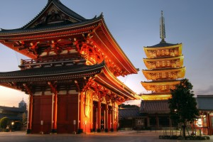 Hozo-mon gate and 5 stories pagoda of the Senso-ji Temple in the Asakusa district of Tokyo, Japan illuminated at sunset. Senso-ji Temple, also known as Asakusa Kannon is the most important of Tokyo temples. Its history starts in the year 628 when a shrine dedicated to Kannon, the Buddhist goddess of mercy was first errected. In 645 was transformed into a temple by Shokai. The ancient buildings were destroyed during the world war 2, but they have been reconstructed according to original plans. HDR image.