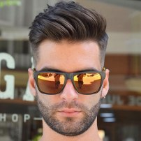 High Taper Fade With Textured Brushed Up Hair