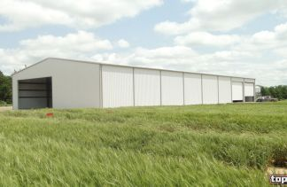 metal farm building by Topline Steel Buildings