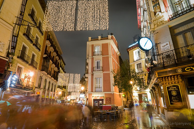 A wet night in December near Plaza Major in Madrid