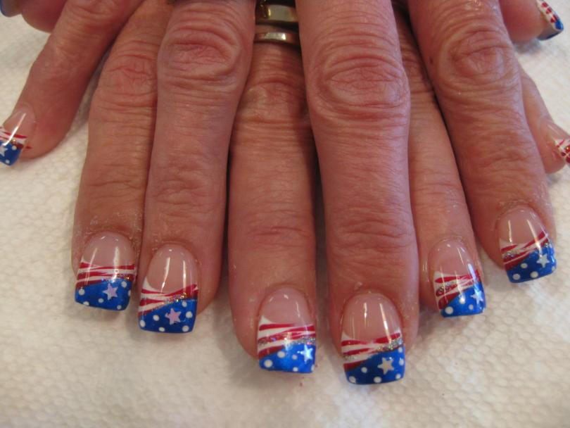 Angled deep blue tip with white dots and star topped with spangled swirl and red/white mixed swirls.