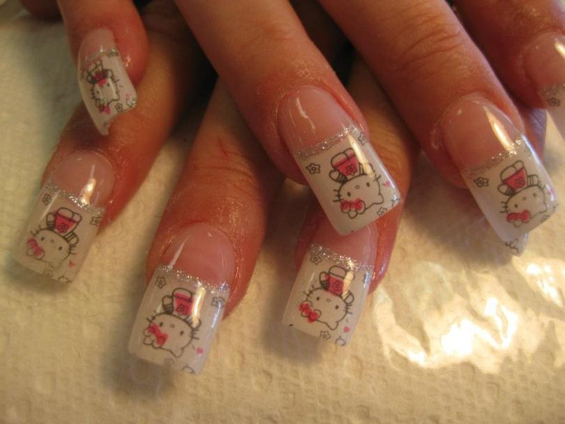 Hello Kitty on cloudy white background topped with band of sparkles.