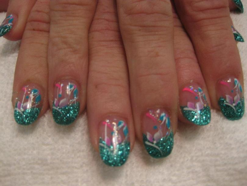 Sparkling dark green tip topped with pink/blue lily petals, bright pink swirl and blue dot.
