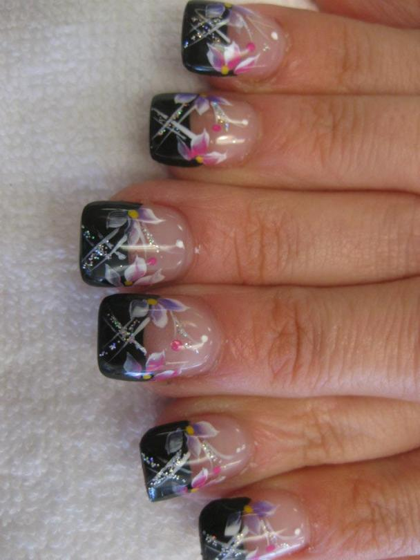Onyx black tip with crossed white/sparkling lily stems topped with pink and lavender lilies, pink dot, and sparkling swirl.