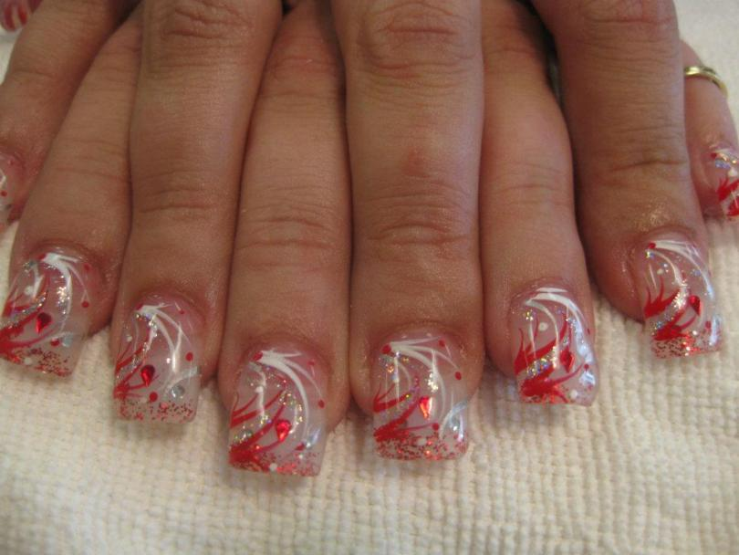 Christmas red teardrop and diamond glue-ons on a cloudy tip with red/white sparkles and red/white/sparkly swirls and red/white dots.