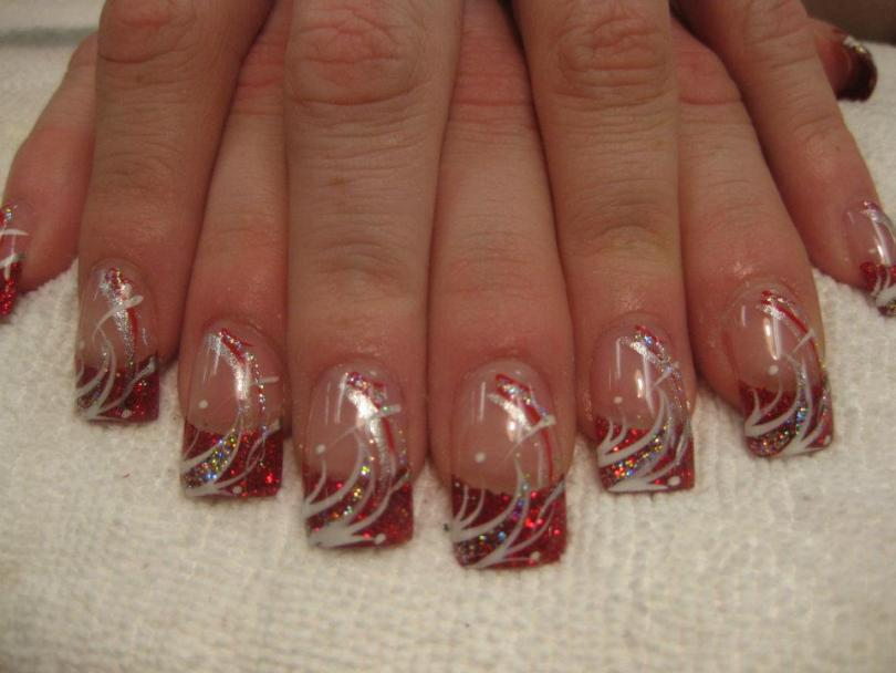 Sparkling Christmas red tip with white/red/sparkly swirls, white dots.