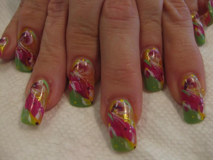 Angled light green tip below angled bright pink band, topped with sparkling gold band with green/orange/pink lilies, dots, and swirls.