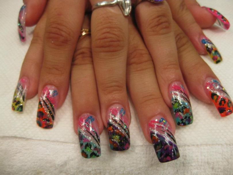 Steeply angled tip (choice of color) topped with multi-colored cheetah-like patterns, sparkly/black/pink/blue swirls.