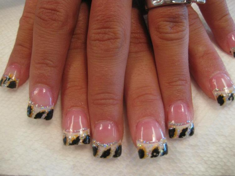 Cloudy tip under black circled by gold leopard spots and sparkles with flesh colored nail.