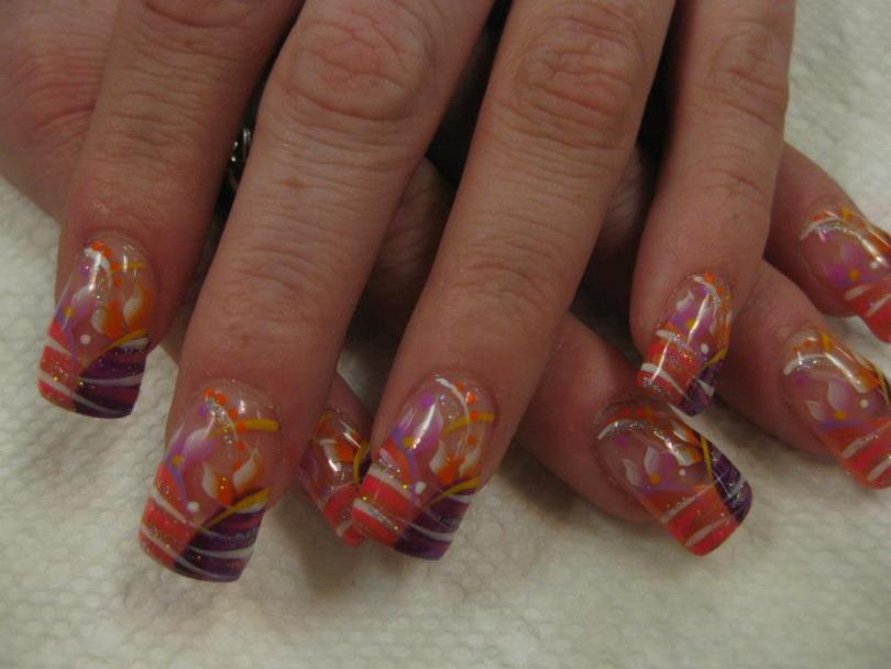 Half curved sparkling orange/half curved sparkling purple tip with pink/white/lavender/orange/yellow/sparkly swirls, orange/white/pink dots.