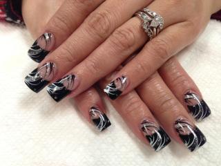 Onyx black tip with diamond glue-ons, white/sparkly/black swirls.