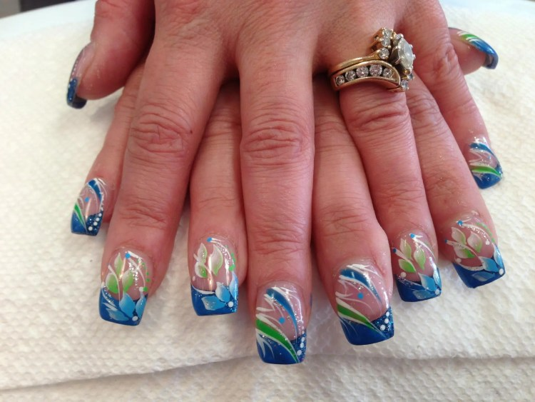 Opaque blue tip with blue/green petals, white/green/blue/sparkly swirls, white/green/blue dots.