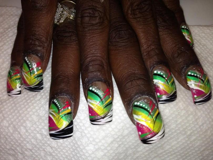 Angled black/white zebra stripe tip, pink triangle, shiny yellow band below shiny green band, white/yellow/pink/black/green/silvery swirls, white/red dots.