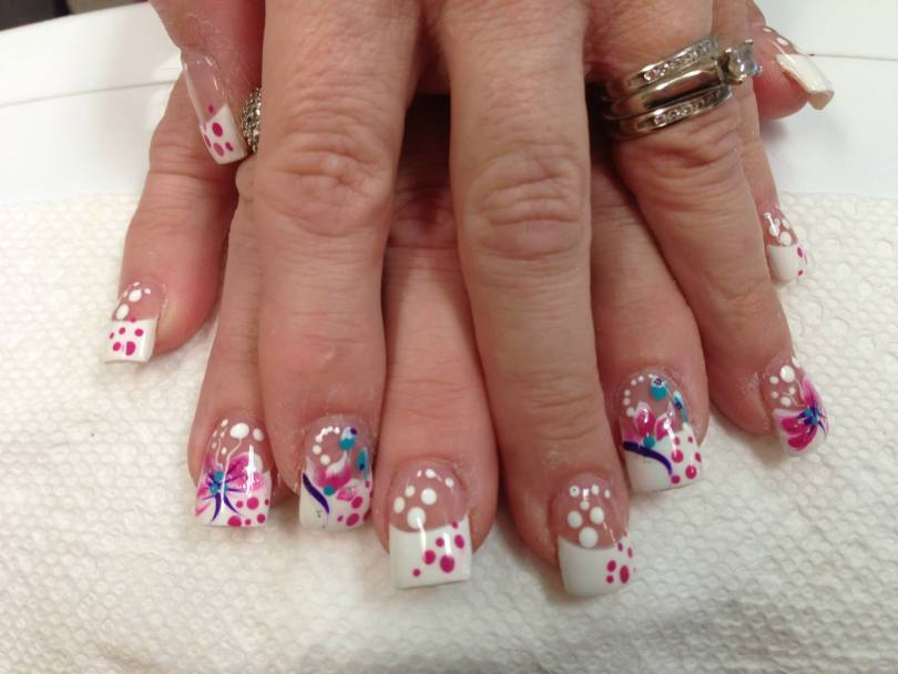 Opaque white tip/pink polka dots, white polka dots over flesh colored nail OR pink/purple/white lily, blue dots.