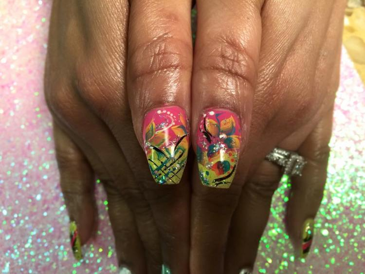 Light green/yellow tip w/angled black/aqua/sparkly hashed lines, bright pink nail w/orange/aqua lilies, diamond glue-on, black/white/sparkly swirls, white dots.
