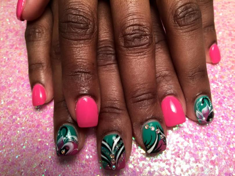 Bright pink nail AND Angled purple tip under turquoise nail w/black/white swirls, diamond glue-ons.