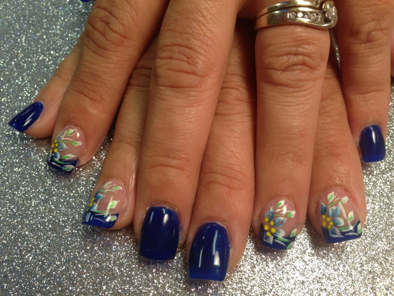Choice: Shiny deep ocean blue nail OR shiny deep ocean blue tip w/blue/white, green/white lily petals, yellow dots, white/green swirls.