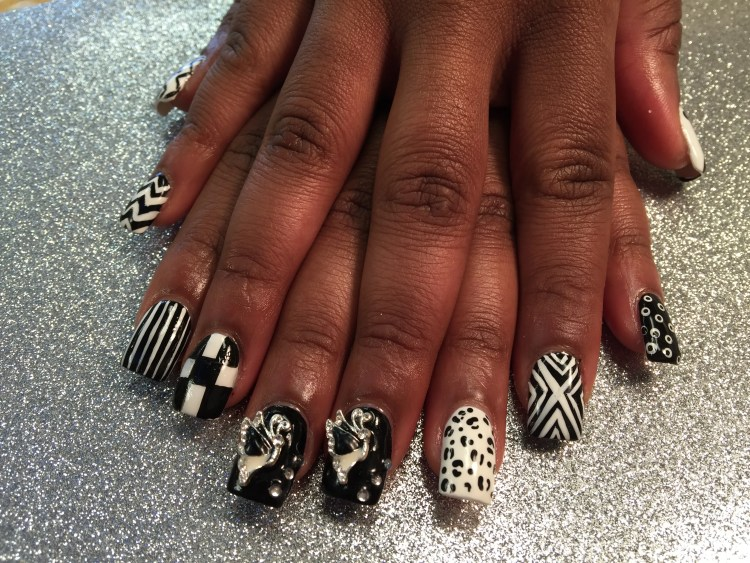 Choice: Black/white vertical stripes, OR X-marks, OR Dalmatian spots, OR white donut-shaped spots on black nail, OR Silver/black/white flying butterfly & diamond glue-ons on black nail.