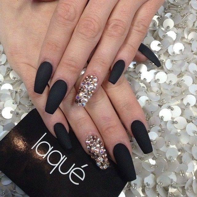 Classy flat black AND diamond glue-on studded extra-long nails.