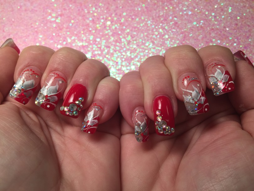 Choice: Shiny brilliant red nail w/diamond glue-ons, OR half-curved brilliant red/half-curved sparkly translucent white tip w/silver/white swishes, mirrored glue-ons, white/red/sparkly swirls, red/white dots.