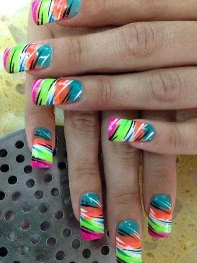 Angled Bright pink tip, under angled neon green, white, peach, and turquoise bands, w/black/white/blue tiger stripes all over.