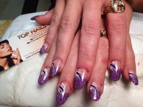 Round purple glitter nails with white curved lines