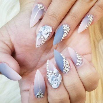 Custom full set dip powder ombre with blings and 3D flower nail art.