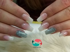 SNS dip powder pink and white ombre with accent silver glitter nails