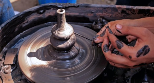 Art work of working on a Pottery wheels
