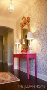 Chic foyer boasts an accent wall painted