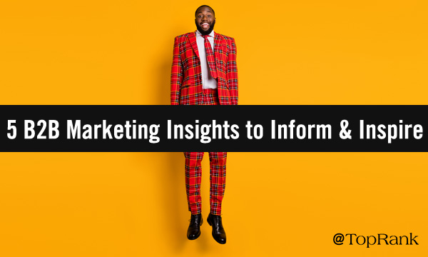 Black businessman in colorful suit jumping with marketing joy against yellow background image.