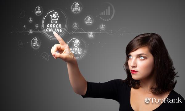 Woman pushing order online button image.