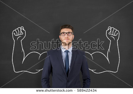 Businessman in front of chalkboard with muscular arms drawn in