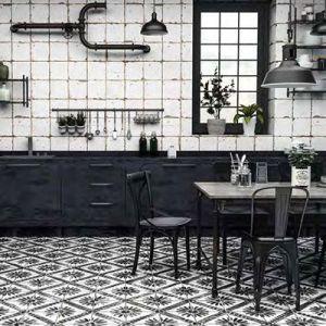 Een keuken in kleine witte afgewassen tegels en oude cementtegels als vloertegel