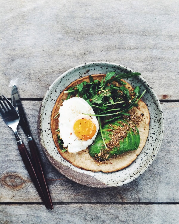 Coconut flour pancake with egg, avocado + dukkah