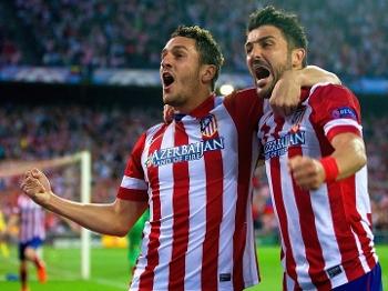 Koke comemora com Villa ao abrir o placar para o Atlético