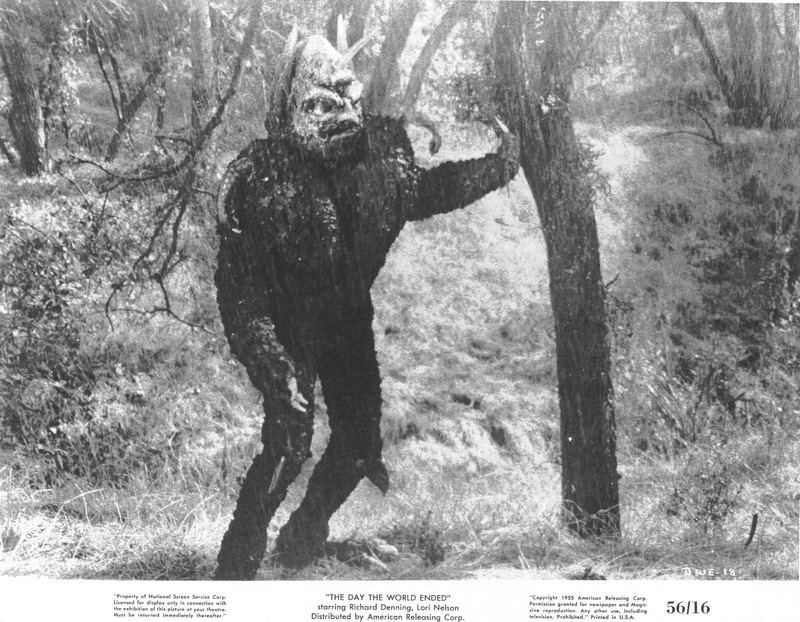 Roger Corman, director, Day the World Ended, 1956, motion picture, ARC.  Trapped in the teeming rain, the Mutant (Paul Blaisdell) slowly succumbs to the rain's purifying effects. Click to enlarge.