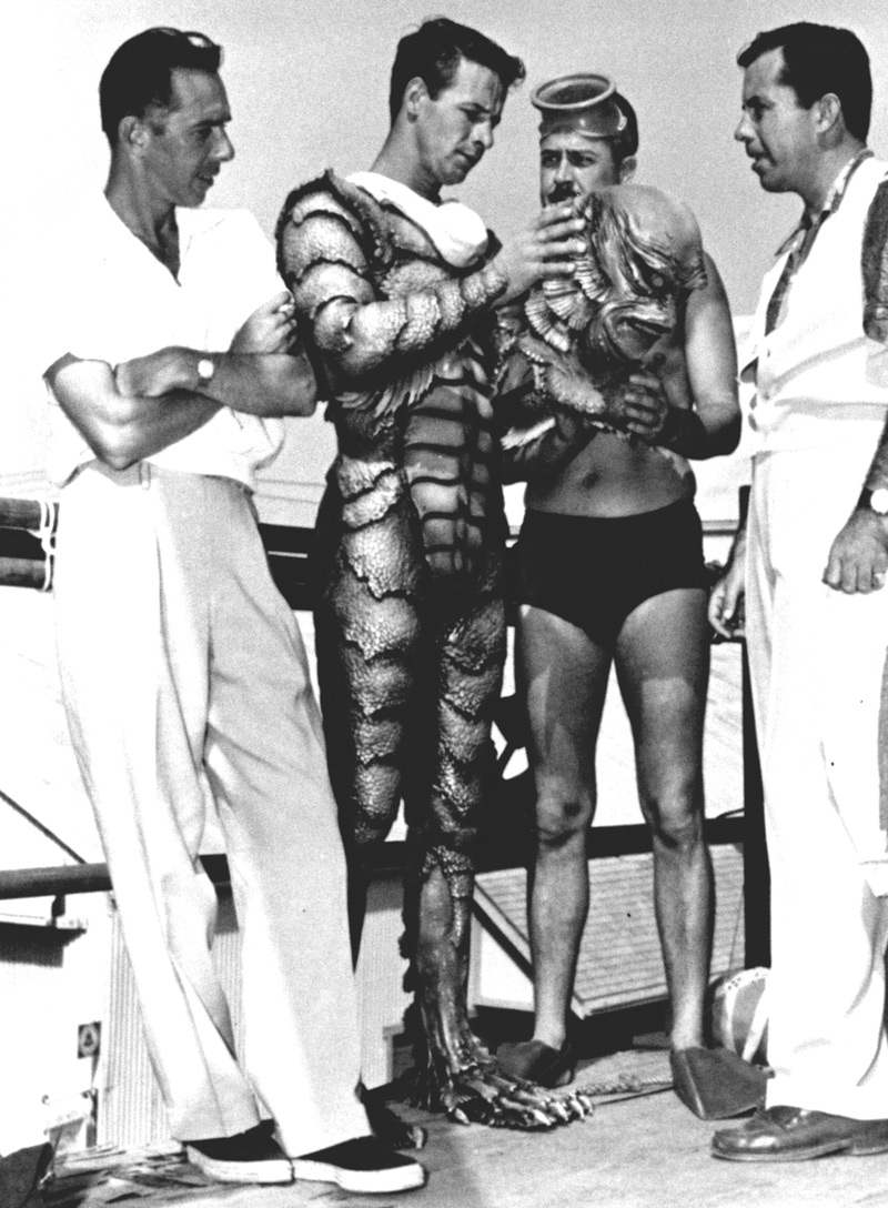 Creature from the Black Lagoon, Universal-International, 1954.  From left to right, director Jack Arnold, actor Ricou Browning, make up man Jack Kevan and make up department head Bud Westmore.  Browning, then in his early 20s and still a student at Florida State University, came by the part of the