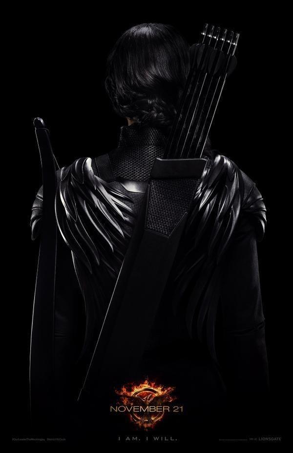 new Mockingjay poster Katniss Everdeen Jennifer Lawrence The Hunger Games District 13 rebels Capitol Panem Peeta Mellark President Snow I am I will