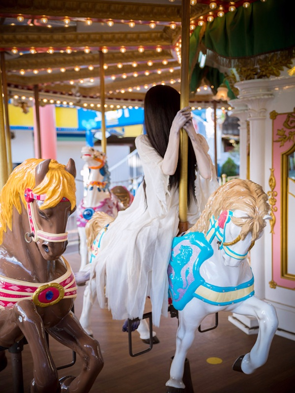 Sadako on a carousel horse