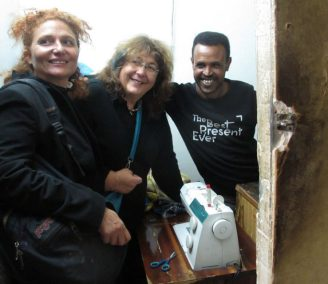 The group's founder Donatella (center) at work in a shelter.