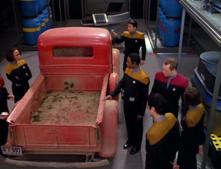 The crew surround a 1930s style truck in Star Trek: Voyager