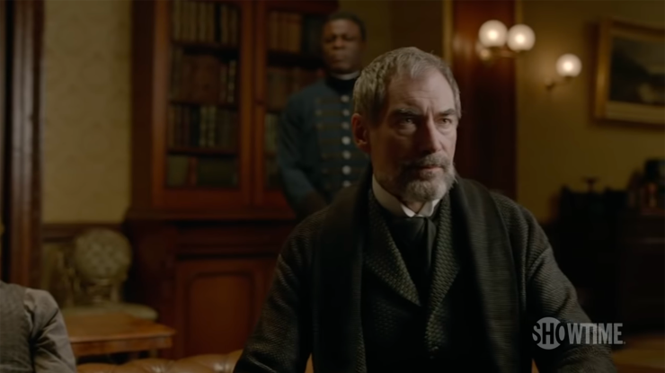 Sembene (Danny Sapani) stands behind Sir Malcolm (Timothy Dalton) in Penny Dreadful