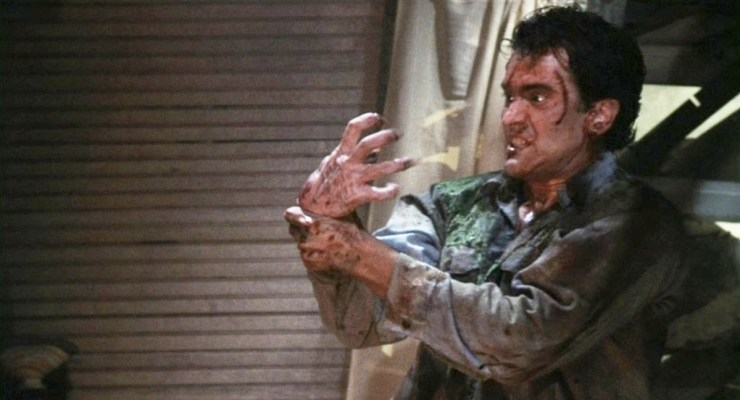 Ash (Bruce Campbell) fights his own demonic hand in Evil Dead II