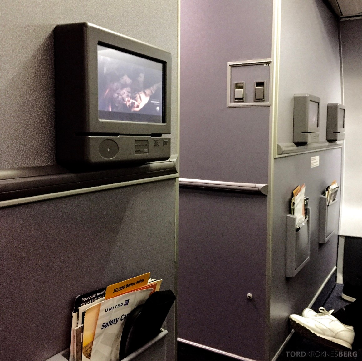 United Airlines Business Class skjerm