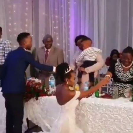 Video Of Bride Kneeling To Greet Guests At Her Wedding Sparks Outrage 1