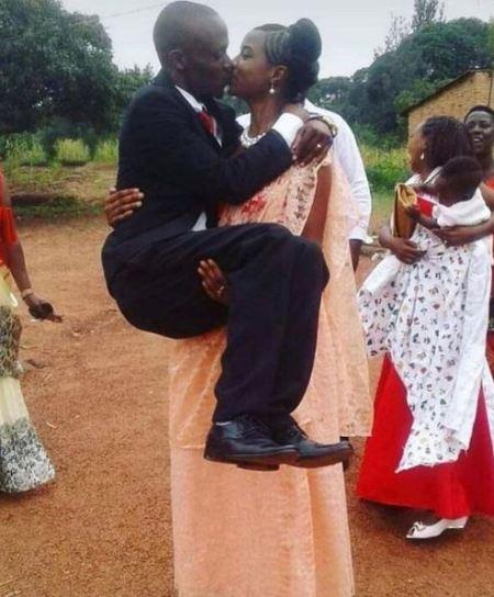 Hilarious: Crazy Photo Of Wedding Couple Kissing 1