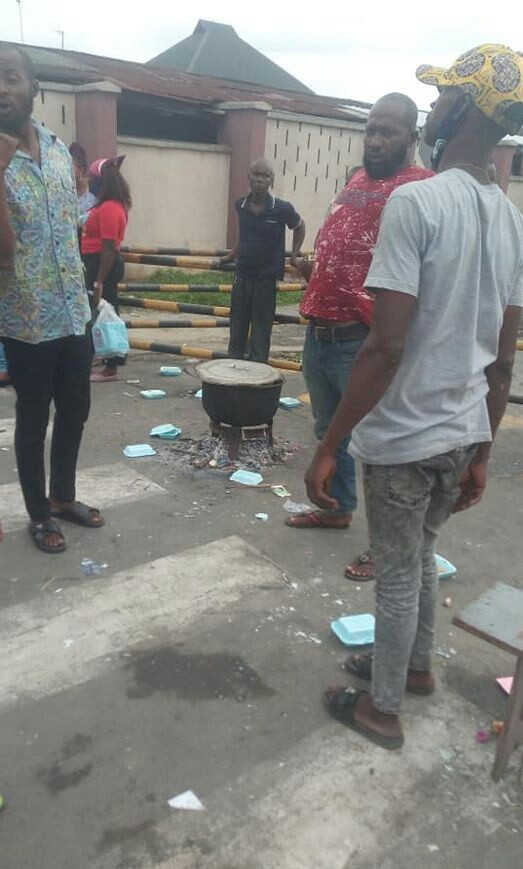 The youths cooked food at the shell premises to protest sack of their kinsmen