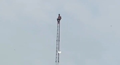 Depressed man on top a mast