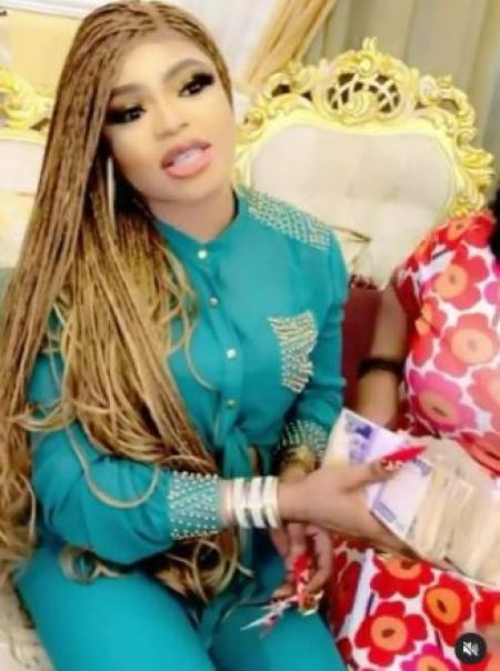 Bobrisky gives woman huge money